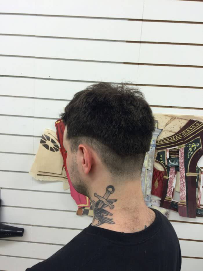 The photo of the back of a customer's head.